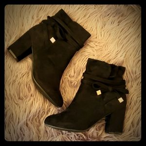 Black faux suade booties with gold side bow